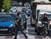 A man, wearing a protective mask due to the COVID-19 pandemic, crosses a street while drivers wait at a traffic light in the Moroccan capital Rabat on June 10, 2020, as the government declared the extension of coronavirus lockdown until July 10. FADEL SENNA / AFP