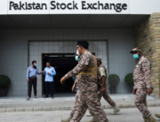 Paramilitary officers inspect the premisses of the Pakistan Stock Exchange building following an attack by gunmen in Karachi on June 29, 2020. Rizwan TABASSUM / AFP