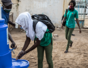 A High School student at the Lycee Blaise Diagne washes her hands as she arrives for her first day back at school in Dakar on June 25, 2020. JOHN WESSELS / AFP
