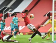 Manchester United's English striker Marcus Rashford (C) controls the ball during the English Premier League football match between Manchester United and Bournemouth at Old Trafford in Manchester, north west England, on July 4, 2020. (Photo by PETER POWELL / POOL / AFP) /