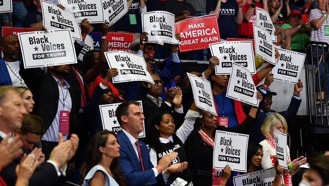 "(FILES) In this file photo taken on June 20, 2020 Governor Kevin Stitt claps among ""Black Voices for Trump"" supporters as US President Donald Trump speaks during a campaign rally at the BOK Center on June 20, 2020 in Tulsa, Oklahoma. (Photo by Nicholas Kamm / AFP)"