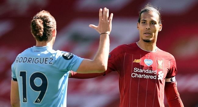 Burnley's English striker Jay Rodriguez (L) and Liverpool's Dutch defender Virgil van Dijk after the English Premier League football match between Liverpool and Burnley at Anfield in Liverpool, north west England on July 11, 2020. (Photo by Oli SCARFF / POOL / AFP)