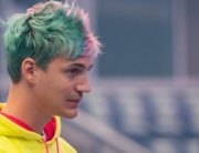 """In this file photo taken on July 27, 2019 Richard Tyler Blevins, aka Ninja, speaks to the crowd at the start of the 2019 Fortnite World Cup Finals - Round Two on July 27, 2019, at Arthur Ashe Stadium, in New York City. - Fortnite superstar Tyler """"Ninja"""" Blevins returned to the streaming world on July 8, 2020 with a match on YouTube, after Microsoft pulled the plug on the Mixer platform where he had an exclusive contract. (Photo by Johannes EISELE / AFP)"""