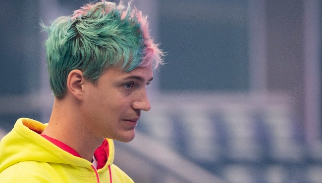 "In this file photo taken on July 27, 2019 Richard Tyler Blevins, aka Ninja, speaks to the crowd at the start of the 2019 Fortnite World Cup Finals - Round Two on July 27, 2019, at Arthur Ashe Stadium, in New York City. - Fortnite superstar Tyler ""Ninja"" Blevins returned to the streaming world on July 8, 2020 with a match on YouTube, after Microsoft pulled the plug on the Mixer platform where he had an exclusive contract. (Photo by Johannes EISELE / AFP)"
