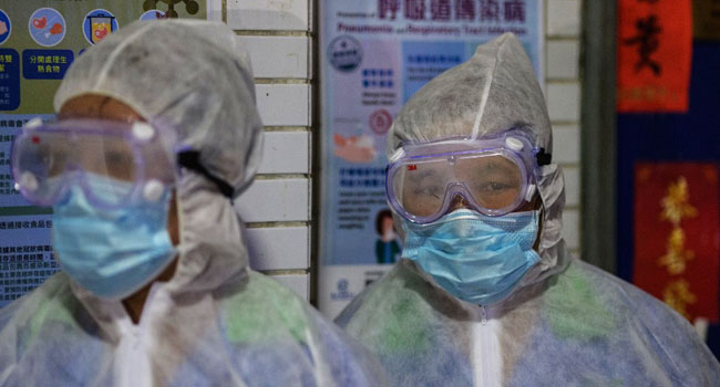 Hong Kong tightens coronavirus restrictions as daily cases hit record high