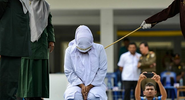 Women Flogged For Online Pimping In Indonesia