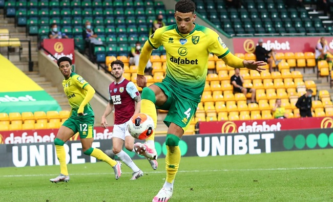 Norwich City's English midfielder Ben Godfrey scores an own goal during the English Premier League football match between Norwich City and Burnley at Carrow Road stadium in Norwich, eastern England on July 18, 2020. (Photo by Julian Finney / POOL / AFP)