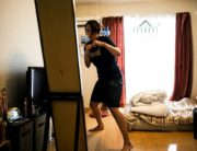This photo taken on June 18, 2020 shows Japanese boxer and nurse Arisa Tsubata exercising at her apartment in Saitama. - Olympic boxing hopeful Arisa Tsubata is used to taking a barrage of blows in the ring but she faces her toughest opponent as a nurse every day: coronavirus. (Photo by Behrouz MEHRI / AFP)