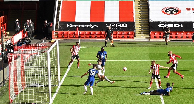 Sheffield United's English-born Irish striker David McGoldrick (R) scores his second goal during the English Premier League football match between Sheffield United and Chelsea at Bramall Lane in Sheffield, northern England on July 11, 2020. (Photo by Shaun Botterill / POOL / AFP)