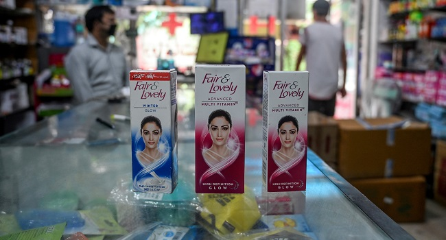 "This photo taken on July 8, 2020 shows packages of Unilever ""Fair and Lovely"" skin-lightening creams on the counter of a shop in New Delhi. - Multinationals have long profited from sales of whitening creams, facewash and even vaginal bleaching lotions, by advertising the message that beauty, success and love are only for pale-skinned people. Now, companies like Unilever say they ""want to lead the celebration of a more diverse portrayal of beauty"". (Photo by Sajjad HUSSAIN / AFP) / TO GO WITH India-Indonesia-Thailand-Philippines-lifestyle-health-racism-gender-caste,FOCUS by Glenda Kwek, Ammu Kannampilly and Archana Thiyagarajan"