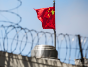 In this file photo taken on July 23, 2020, the Chinese flag flies behind barbed wire at the Chinese Consulate General in San Francisco. Philip Pacheco / AFP