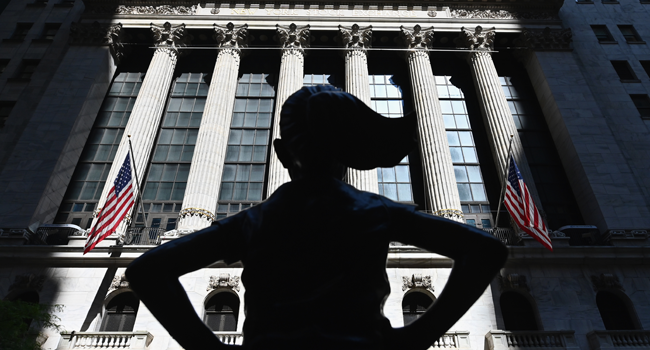 "In this file photo taken on June 29, 2020, The ""Fearless Girl"" statue stands in front of the New York Stock Exchange (NYSE) at Wall Street in New York City. Angela Weiss / AFP"
