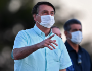 Brazilian President Jair Bolsonaro gestures as he speaks to supporters outside Alvorada Palace in Brasilia, on July 22, 2020. EVARISTO SA / AFP
