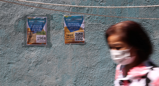 This file photo taken on July 11, 2020 shows information posters posted on a wall at a New Territories East polling station during a primary election in Hong Kong. May JAMES / AFP