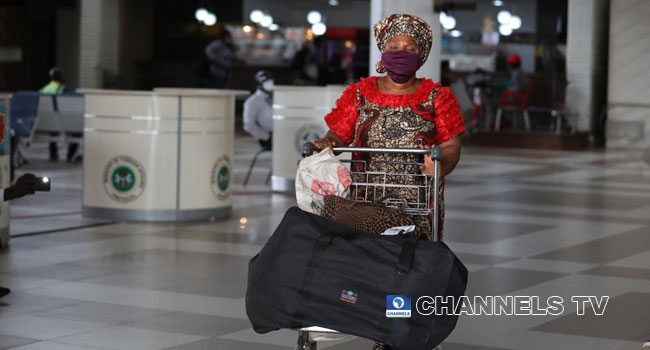 PHOTOS: Nigerians Comply With COVID-19 Protocols As Domestic Flights Resume