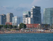 People enjoy a day at El Bogatell Beach in Barcelona on July 1, 2020. Josep LAGO / AFP