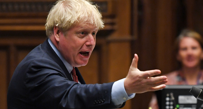 A handout photograph released by the UK Parliament shows Britain's Prime Minister Boris Johnson during Prime Minister's Questions (PMQs) in the House of Commons in London on July 15, 2020. JESSICA TAYLOR / AFP / UK PARLIAMENT