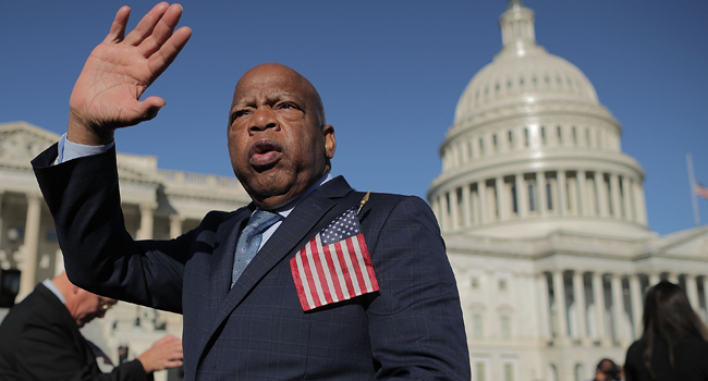 In this file photo taken on October 03, 2017 Rep. John Lewis (D-GA) thanks anti-gun violence supporters following a rally with fellow Democrats on the East Front steps of the U.S. House of Representatives October 4, 2017 in Washington, DC. CHIP SOMODEVILLA / GETTY IMAGES NORTH AMERICA / AFP