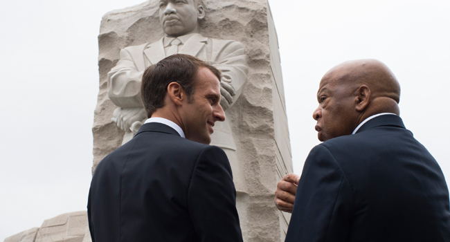 In this file photo taken on April 25, 2018 France's President Emmanuel Macron stands with US Rep. John Lewis(D-GA) in front of the Martin Luther King,Jr. Memorial in Washington, DC. Eric BARADAT / AFP