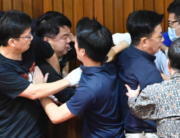Legislators from Taiwan's main opposition Kuomintang (KMT) and ruling Democratic Progressive Party (DPP) scuffle as the KMT protest against Taiwan President Tsai Ing-wen's nomination of Chen Chu, former secretary general of the President Office, for the chairwoman of the Control Yuan, the country's watchdog body of other branches of government, as scuffles broke out during voting at the parliament in Taipei on July 17, 2020.