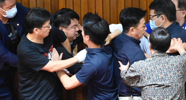 Taiwan Lawmakers Throw Punches, Water Balloons In Parliament Crisis