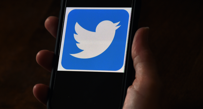 In this file photo illustration, a Twitter logo is displayed on a mobile phone on May 27, 2020, in Arlington, Virginia. Olivier DOULIERY / AFP
