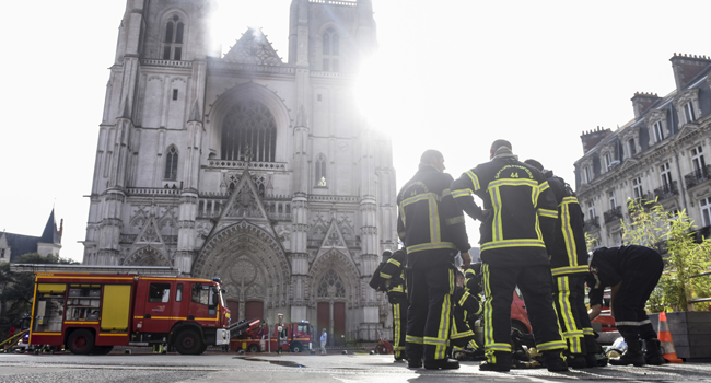 Firefighters are at work to put out a fire at the Saint-Pierre-et-Saint-Paul cathedral in Nantes, western France, on July 18, 2020. Sebastien SALOM-GOMIS / AFP