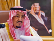 This file handout photo provided by the Saudi Royal Palace on March 19, 2020, shows King Salman bin Abdulaziz addressing the nation in a televised speech regarding the COVID-19 pandemic, in the capital Riyadh. Bandar AL-JALOUD / Saudi Royal Palace / AFP