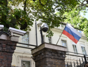 A Russian flag flies by surveillance cameras at the entrance to the Russian consulate in London on July 21, 2020. JUSTIN TALLIS / AFP