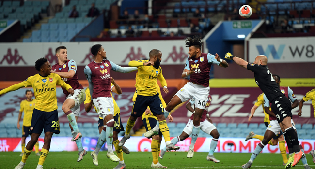 Aston Villa's Spanish goalkeeper Pepe Reina (R) jumps for the ball during the English Premier League football match between Aston Villa and Arsenal at Villa Park in Birmingham, central England on July 21, 2020. Shaun Botterill / POOL / AFP