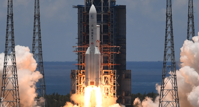 A Long March-5 rocket, carrying an orbiter, lander and rover as part of the Tianwen-1 mission to Mars, lifts off from the Wenchang Space Launch Centre in southern China's Hainan Province on July 23, 2020. Noel CELIS / AFP