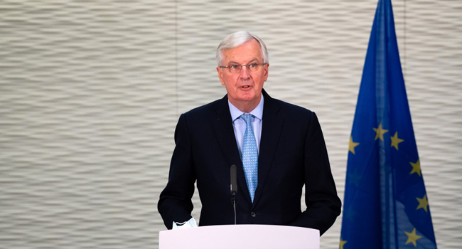 A handout picture released by the European Commission on July 23, 2020 shows EU chief Brexit negotiator Michel Barnier delivering a statement at a press conference at the offices of the Delegation of the European Union to the UK at Europe House in London on July 23, 2020. Niklas HALLE'N / European Commission / AFP