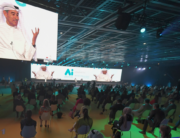 """The image of Emirati businessman Mohamed Alabba is projected on large screens as he speaks at the first """"real life"""" conference in the Gulf city of Dubai, on July 16, 2020, since the coronavirus protective restrictions were put in place in March. KARIM SAHIB / AFP"""