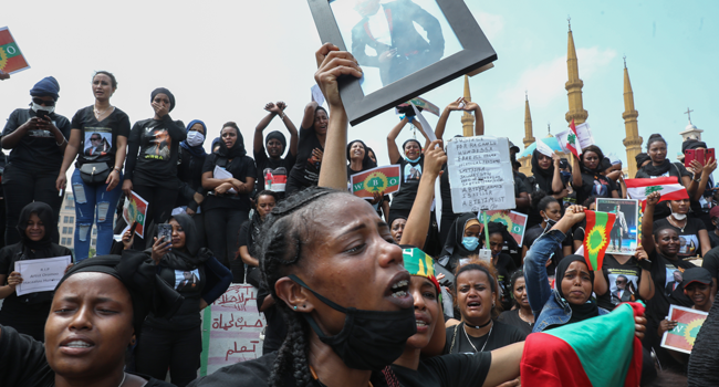 Members of the Oromo Ethiopian community in Lebanon take part in a demonstration to protest the death of musician and activist Hachalu Hundessa, in the capital Beirut on July 5, 2020. ANWAR AMRO / AFP
