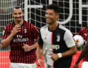 AC Milan's Swedish forward Zlatan Ibrahimovic (L) reacts next to Juventus' Portuguese forward Cristiano Ronaldo (C) after scoring a penalty during the Italian Serie A football match AC Milan vs Juventus played behind closed doors on July 7, 2020 at the San Siro stadium in Milan, as the country eases its lockdown aimed at curbing the spread of the COVID-19 infection, caused by the novel coronavirus. Miguel MEDINA / AFP
