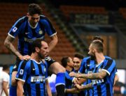 Inter Milan's Uruguayan defender Diego Godin(L) celebrates with Inter Milan's Italian defender Alessandro Bastoni(top) and Inter Milan's Croatian defender Marcelo Brozovic after scoring his team's second goal during the Italian Serie A football match Inter Milan vs Torino played behind closed doors on July 13, 2020 at the San Siro stadium in Milan. (Photo by MIGUEL MEDINA / AFP)