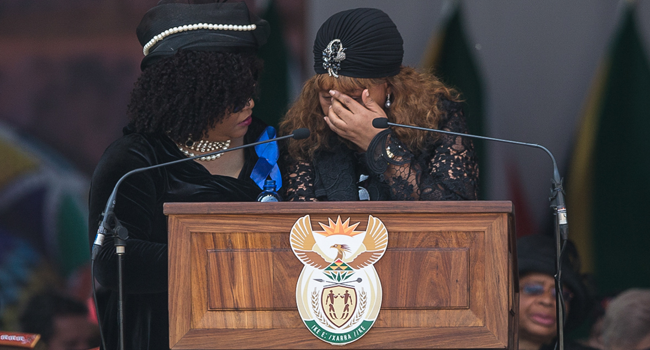 Zenani Mandela-Dlamini (R) and Zindzi Mandela (L), daughters of the late anti-apartheid icon Winnie Madikizela-Mandela, react as they give their speech during her funeral at the Orlando Stadium in the township of Soweto, concluding 10 days of national mourning on April 14, 2018, in Johannesburg. Wikus DE WET / AFP
