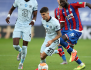 Chelsea's US midfielder Christian Pulisic (C) is chased by Crystal Palace's Senegalese midfielder Cheikhou Kouyate (R) during the English Premier League football match between Crystal Palace and Chelsea at Selhurst Park in south London on July 7, 2020. PETER CZIBORRA / POOL / AFP