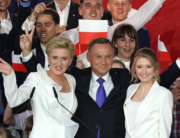 Polish President Andrzej Duda flashes V-signs after addressing supporters with his wife Agata as exit poll results were announced during the presidential election in Pultusk, Poland, on July 12, 2020 . JANEK SKARZYNSKI / AFP