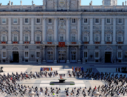 Attendees sit around a cauldron during a state ceremony to honour the 28,400 victims of the coronavirus crisis as well as those public servants who have been fighting on the front line against the pandemic in Spain, on July 16, 2020, at the Royal Palace in Madrid. Juanjo Martin / POOL / AFP