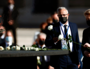 President of the European Commision Ursula von der Leyen (R) leaves a whote rose next to a cauldron as she attends a state ceremony to honour the 28,400 victims of the coronavirus crisis as well as those public servants who have been fighting on the front line against the pandemic in Spain, on July 16, 2020, at the Royal Palace in Madrid. Mariscal / POOL / AFP