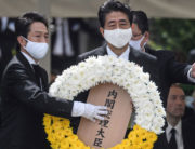Japanese Prime Minister Shinzo Abe lays a wreath during a ceremony marking the 75th anniversary of the atomic bombing of Nagasaki, at the Nagasaki Peace Park on August 9, 2020. Philip FONG / AFP
