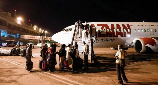 PHOTOS: 117 Stranded Nigerians Return From Rwanda, Uganda, Tanzania
