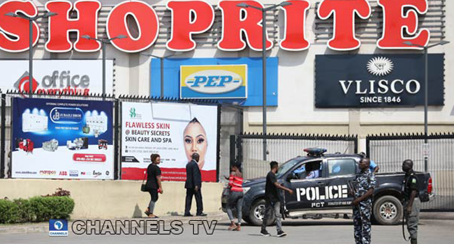 Police protect a shoprite store in Abuja amid protests against Xenophobic attacks on Nigerians in South Africa. Photo: Sodiq Adelakun/Channels TV