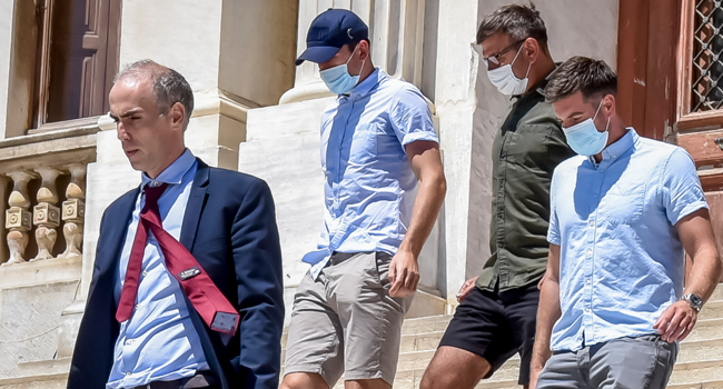 Manchester United football team captain Harry Maguire (2nd L) leaves a courthouse on the Greek island of Syros, the administrative hub of the Cycladic island group that includes Mykonos on August 22, 2020. EUROKINISSI / AFP