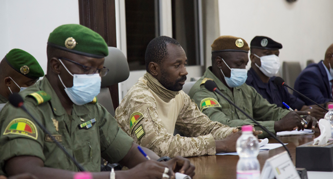 President of the CNSP (National Committee for the Salvation of the People) Assimi Goita (C) prepares for a meeting between Malian military leaders and an ECOWAS delegation headed by former Nigerian president on August 22, 2020, in an aim to restore order after the military coup in Bamako. ANNIE RISEMBERG / AFP