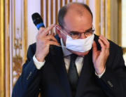 French Prime Minister Jean Castex puts his protective face mask on during a press conference on the situation of the novel coronavirus (Covid-19) in France, at the Hotel de Matignon in Paris on August 27, 2020. CHRISTOPHE ARCHAMBAULT / POOL / AFP