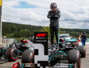 Mercedes' British driver Lewis Hamilton gestures in homage to late US actor Chadwick Boseman, as he stands on his car after securing his 93rd pole position during the qualifying session at the Spa-Francorchamps circuit in Spa on August 29, 2020 ahead of the Belgian Formula One Grand Prix. FRANCOIS LENOIR / POOL / AFP