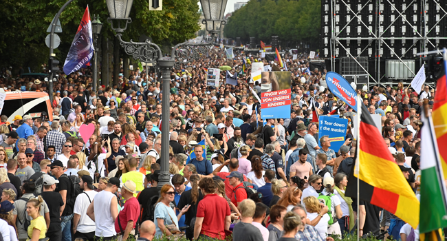 Participants wave national flags during a gathering on the 17. Juni avenue in Berlin at the end of a demonstration called by far-right and COVID-19 deniers to protest against restrictions related to the new coronavirus pandemic, on August 29, 2020. John MACDOUGALL / AFP