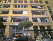 This picture taken on August 4, 2020 shows a general view of destruction outside a building in the centre of Lebanon's capital Beirut, following a massive explosion at the nearby port of Beirut. STR / AFP